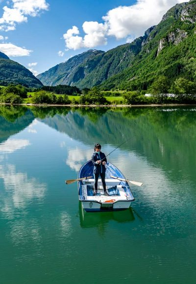 woman-fishing-on-a-boat-XM5YGAE-resize