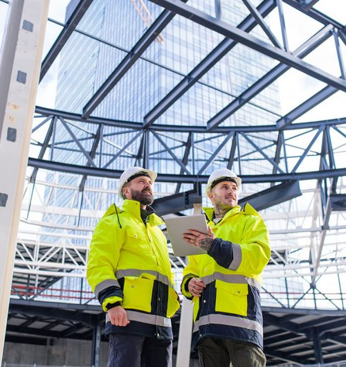 men-engineers-standing-outdoors-on-construction-si-small